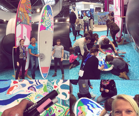 "painting the board at the ""Love your Ocean"" booth at the BOOT Düsseldorf"