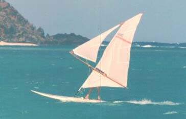 Split Lateen Sailboard rig designed and built by S. Newman Darby. Sail sown by Naomi Darby and designed for Mistral in late 1970's. Photo taken in Hawaii by S. Newman Darby.