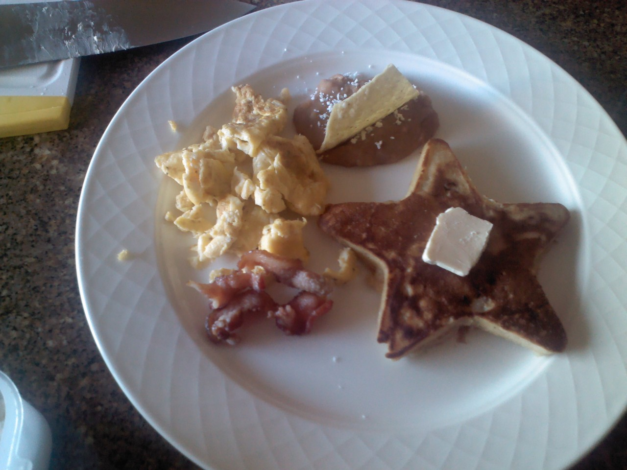 Enjoy a delicious American breakfast. scrambled eggs, pancakes stuffed with banana and walnut. and crispy bacon
