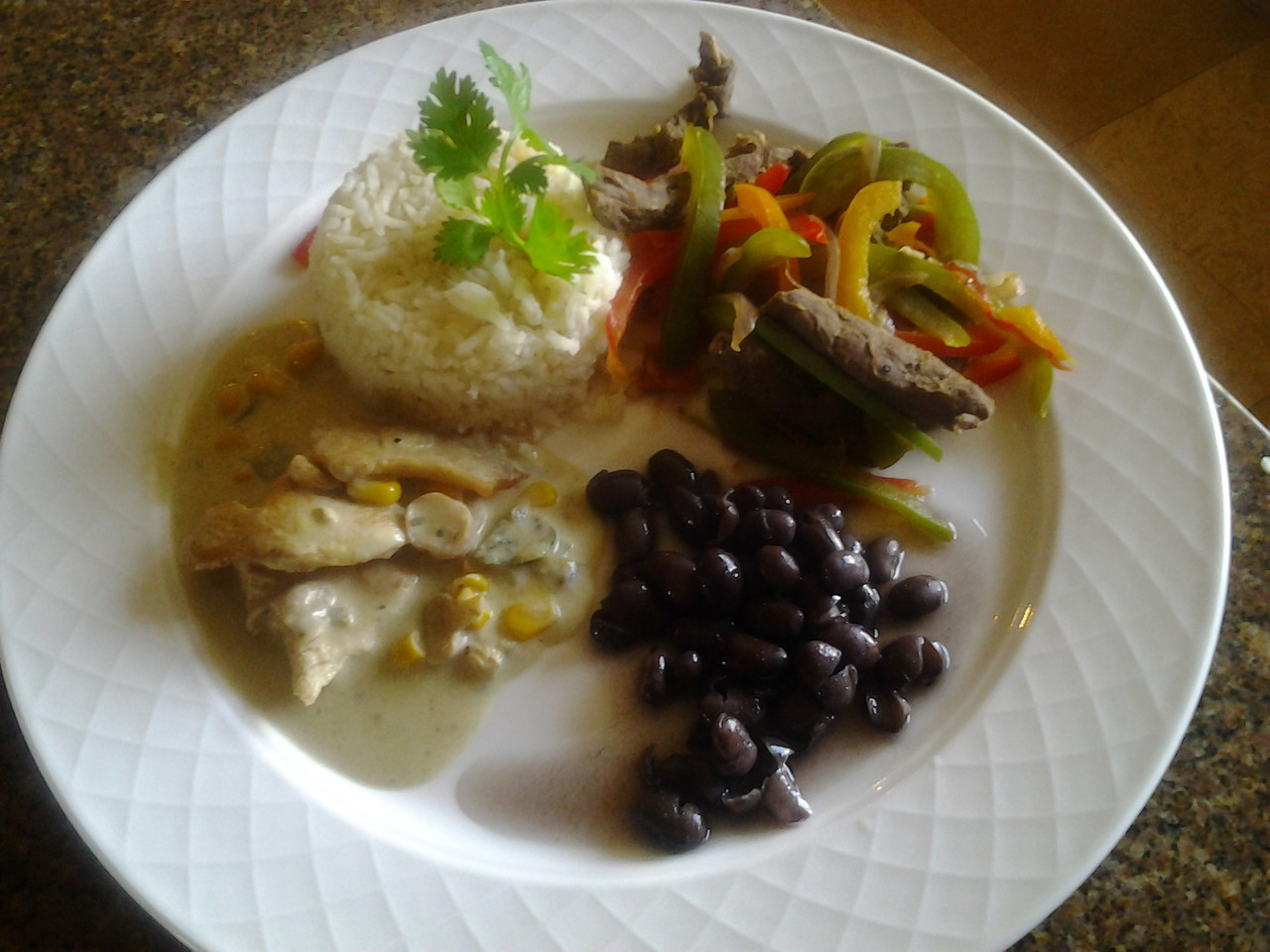 Chicken Rafaela , chicken fajitas grilled, bathed in a creamy mushroom sauce with poblano peppers,    Flank Steak Fajitas Steamed rice and black beans Cuban style
