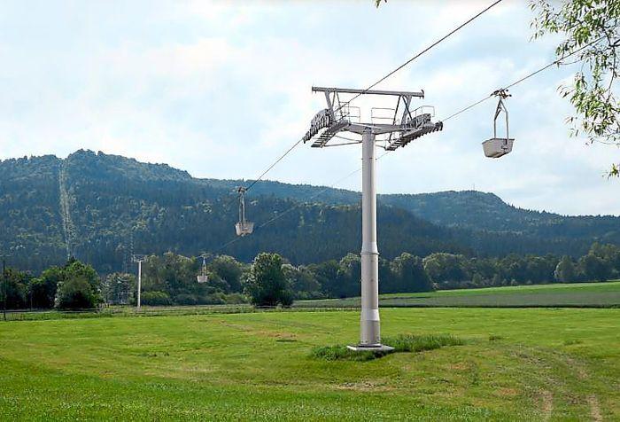 Runde Stahlstützen statt Gittermasten und mehr Loren: So soll die neue Seilschwebebahn von Holcim aussehen. Foto: Holcim