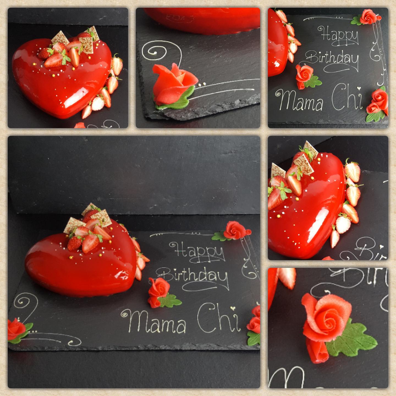 Herztorte mit knallrotem Mirror Glaze und handmodellierten roten Marzipanrosen