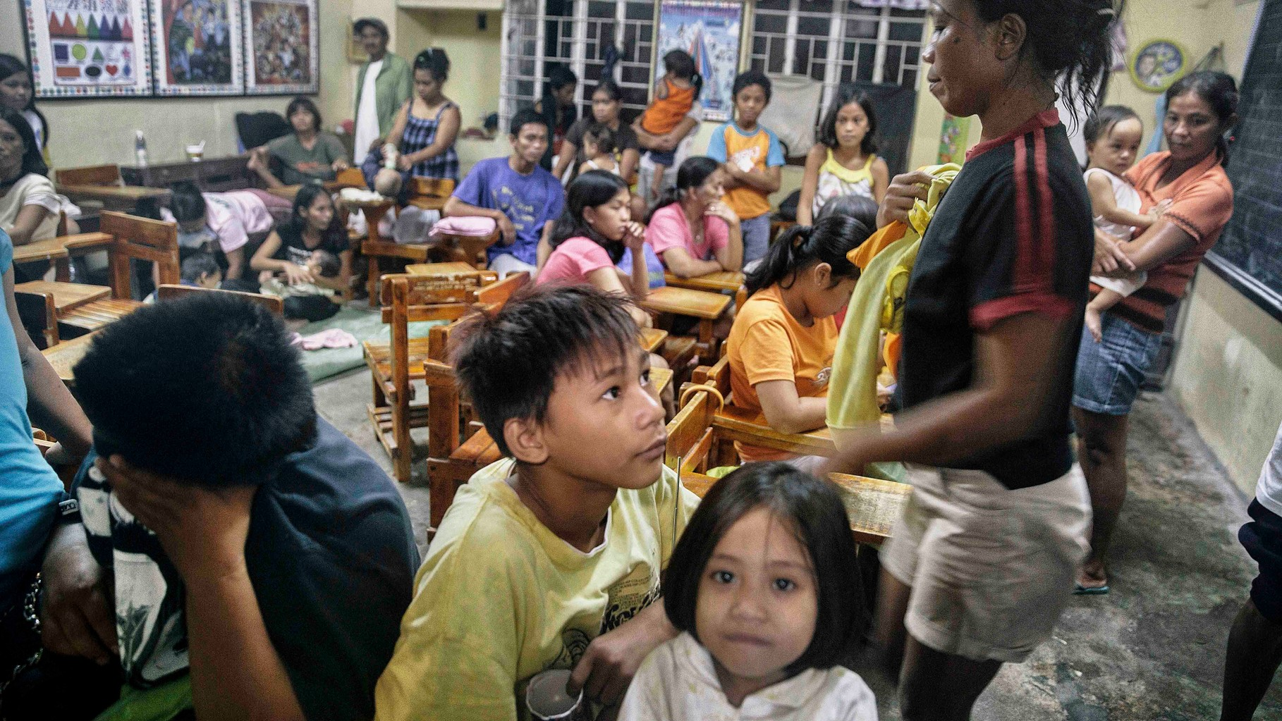 People rush to evacuation centres in Cavite suprised by the sudden flood