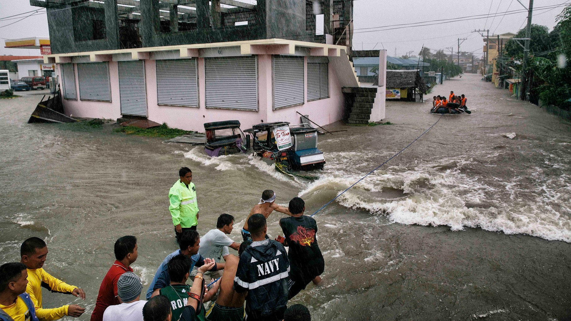 Philippine Navy rescue flood victims in Cavite near the sea