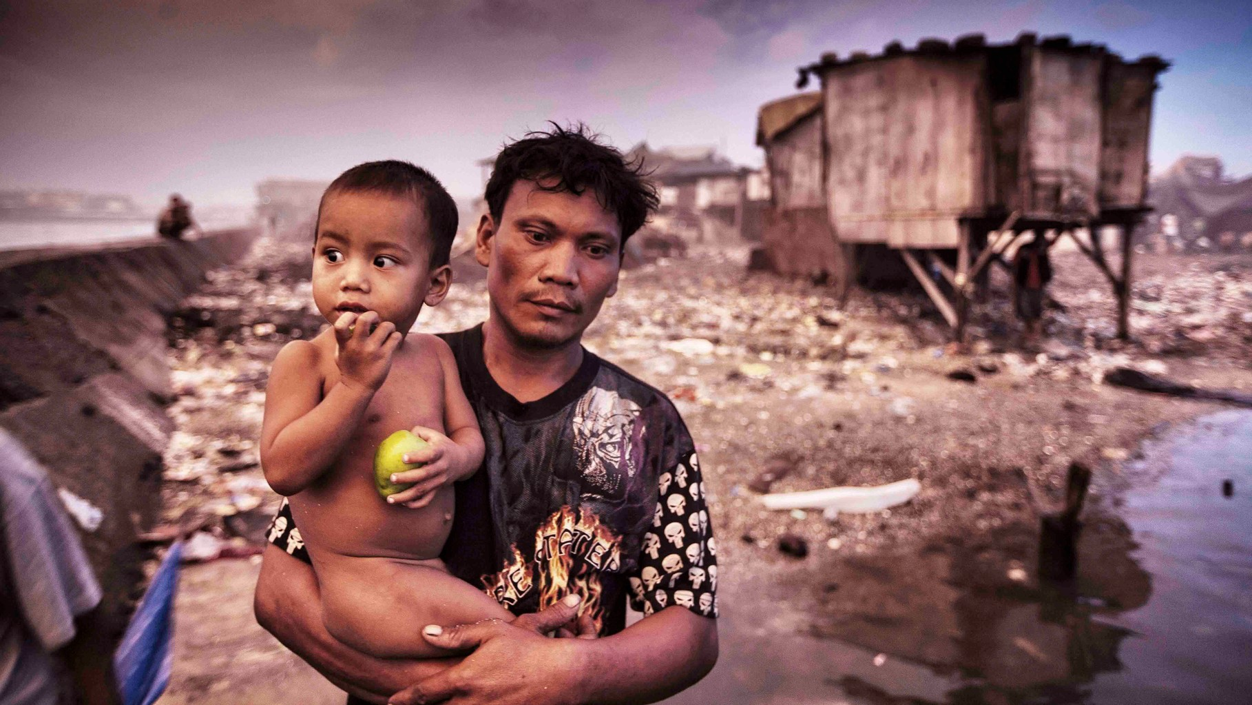 a father with his son in Tondo at Manila Bay after the typhoon