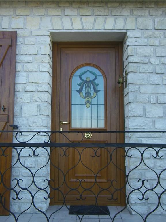 Porte d'entrée en alluminium décor chêne
