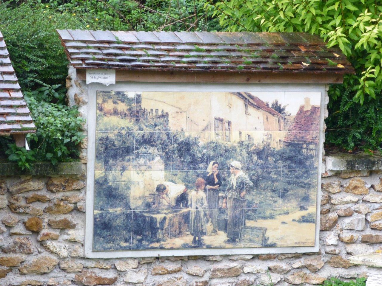 """À Mont-Saint-Père, une fresque céramique reproduisant le tableau """"À la fontaine"""" peint, ici, par Léon Lhermitte en 1895, embellit la restauration du lavoir."""