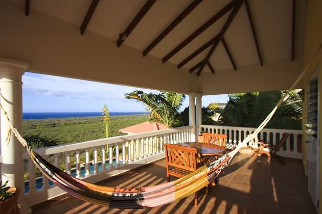 Relax in de hangmat op het balkon van de master bedroom