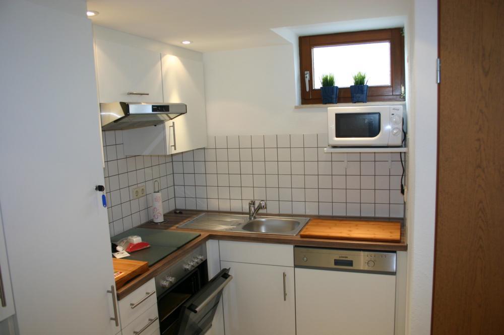 Küche für 6 Personen ausgestattet, inkl. Mikrowelle, Kaffeemaschine und Spülmaschine