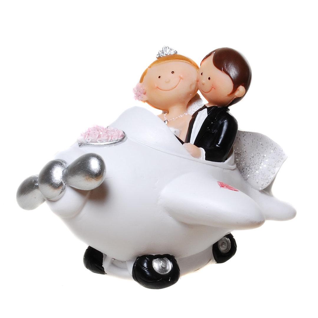 Comic-Brautpaar im Flugzeug
