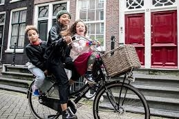 Cycling mum with two children in Amsterdam