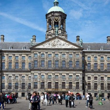 Amsterdam palace with people on the Dam square