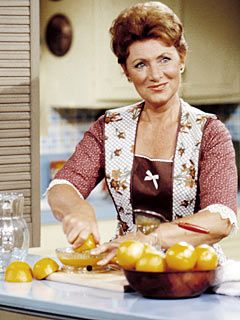 Mrs Cunningham, the ideal 50s housewife, in the kitchen preparing food for Howard and the kids (although not for Chuck)