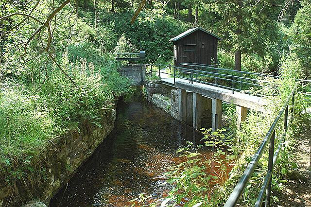 A water regulation system at the Dammgraben ditch near Altenau is part of the Oberharz Wasserregal, the historical water rights once conferred on the Upper Harz area by the King. Photographer: Gerhard Elsner; source: de.wikipedia.org
