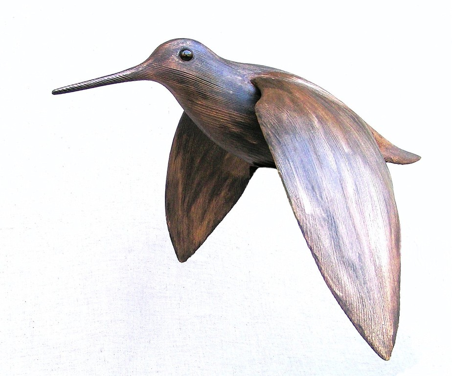Sculpture de becasse en vol oiseau en bois