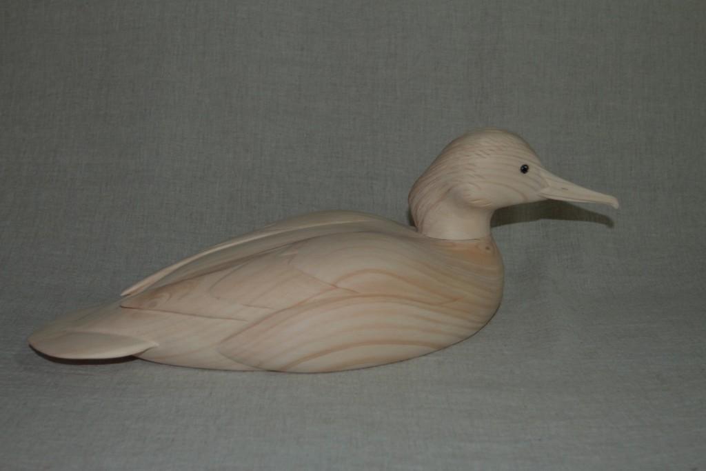 Sculpture d'oiseau en bois:harle bièvre mâle