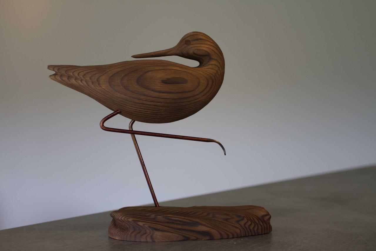 oiseau de bois: chevalier patte en l'air cou retouné