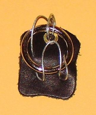 contribution,pendant,metals,leather