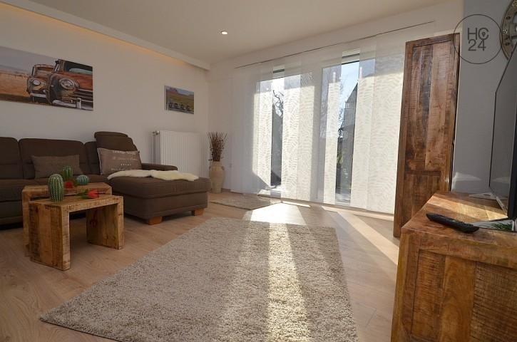 Wohnzimmer im Fuchsbau 1 mit Zugang zur Terrasse