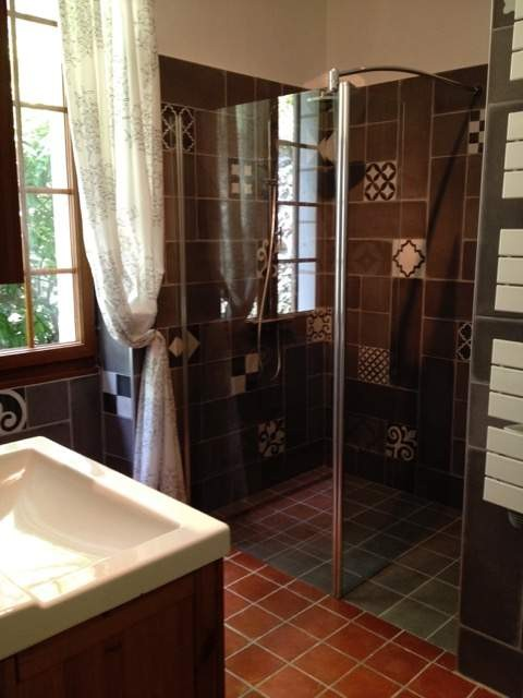 comfortable bathroom with big shower