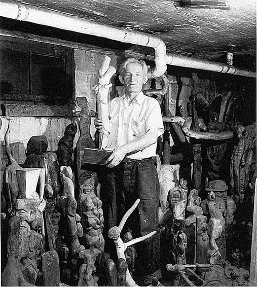 Samuel Surrounded By Sculpture In His Basement