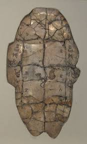 idéogrammes chinois sur carapace de tortue