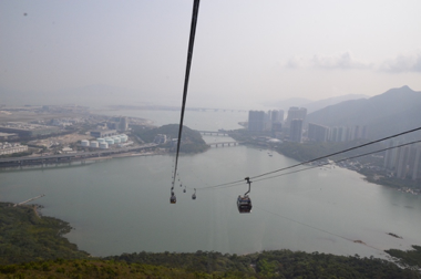 View from the cable car, on the left hand-side you can see parts of the airport of Hong Kong.
