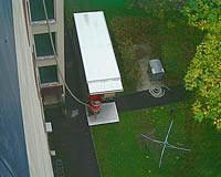 Förderschlauch vom LKW auf das Dach