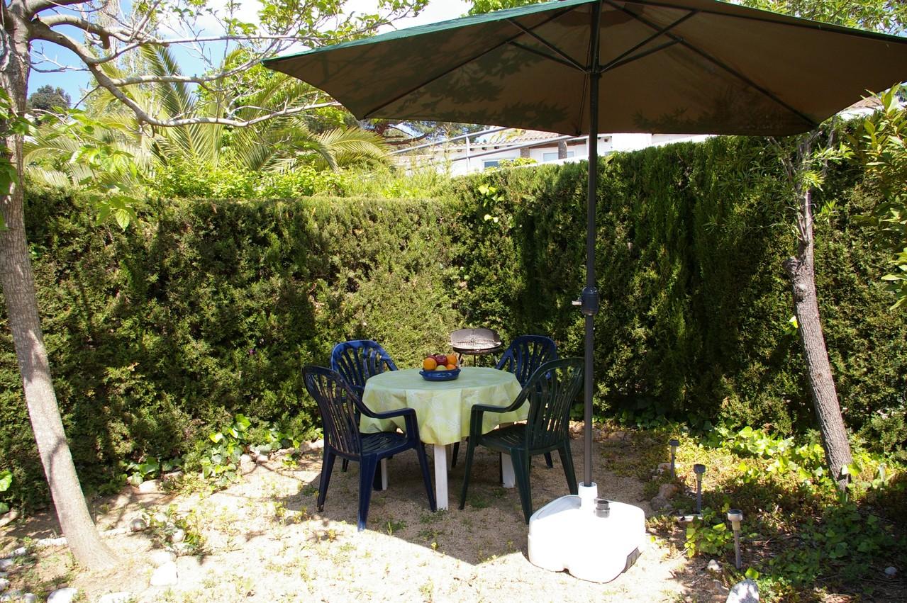 Casa de vacaciones con piscina en Tossa de Mar, jardín con barbacoa