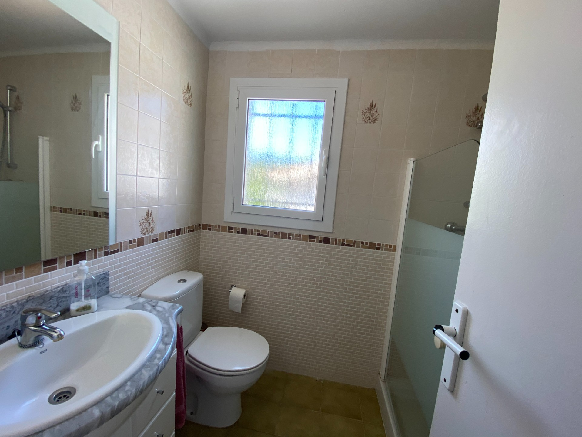 Renovated bathroom with shower