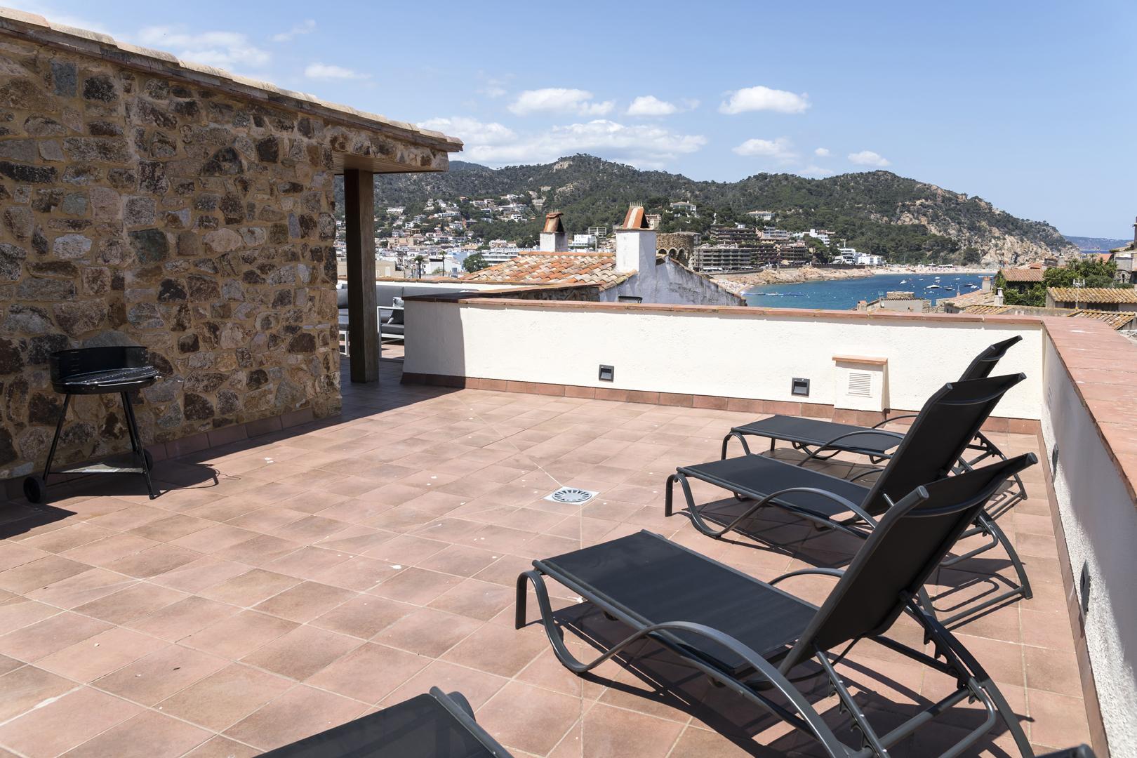 Terrace area with sun loungers