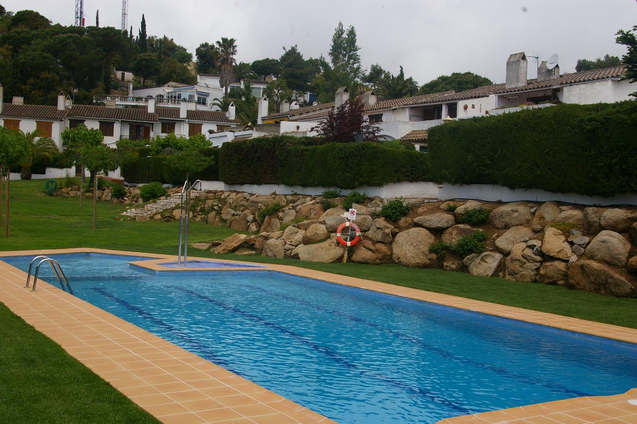 Casa de vacaciones con piscina en Tossa de Mar, piscina comunitaria