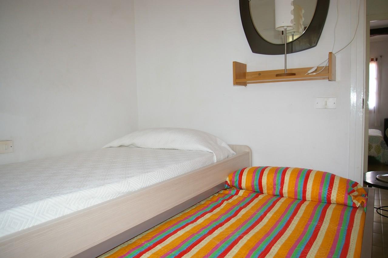 Casa de vacaciones con piscina en Tossa de Mar, dormitorio dos camas