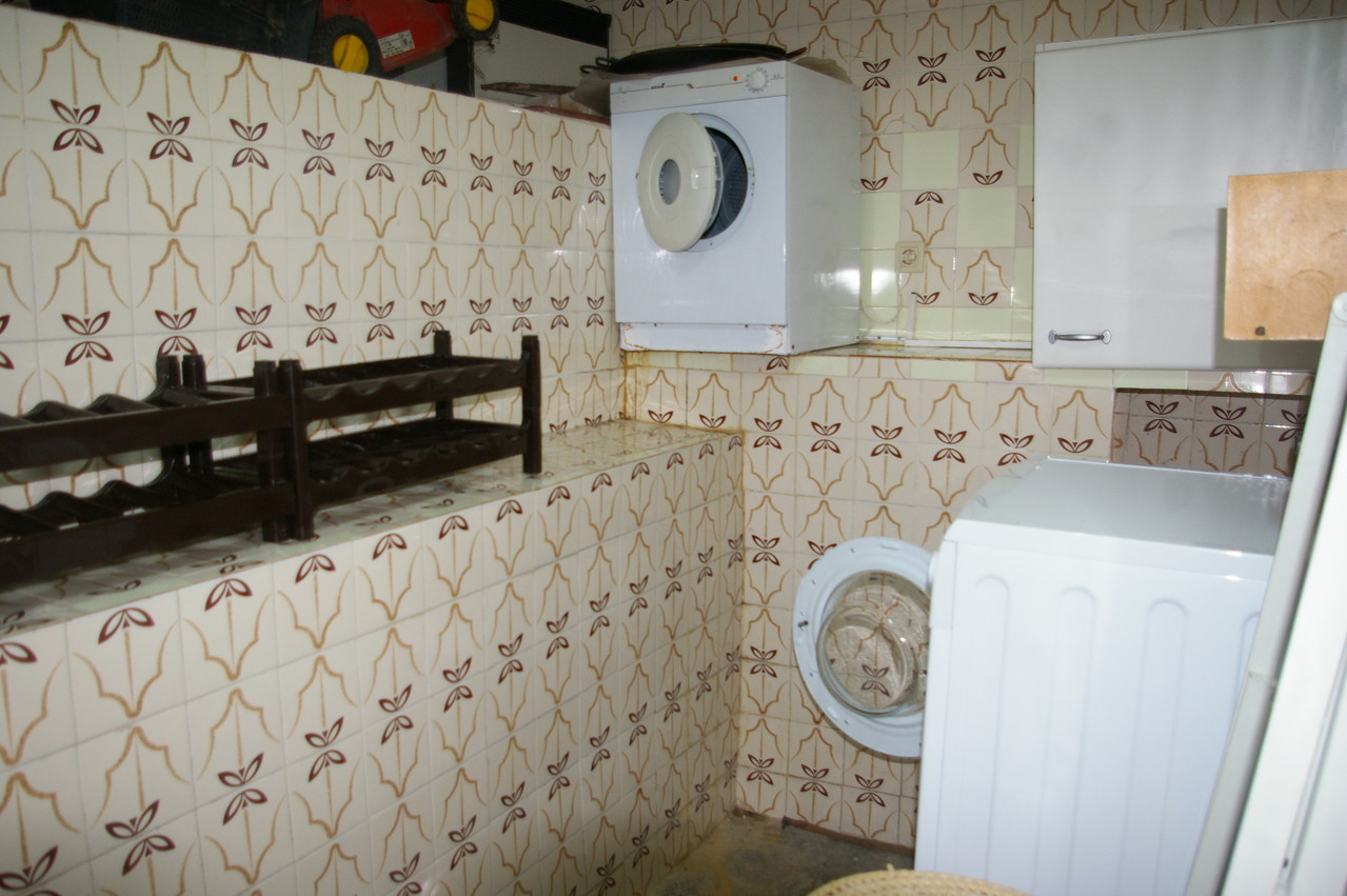 room with washing machine, dryer and small