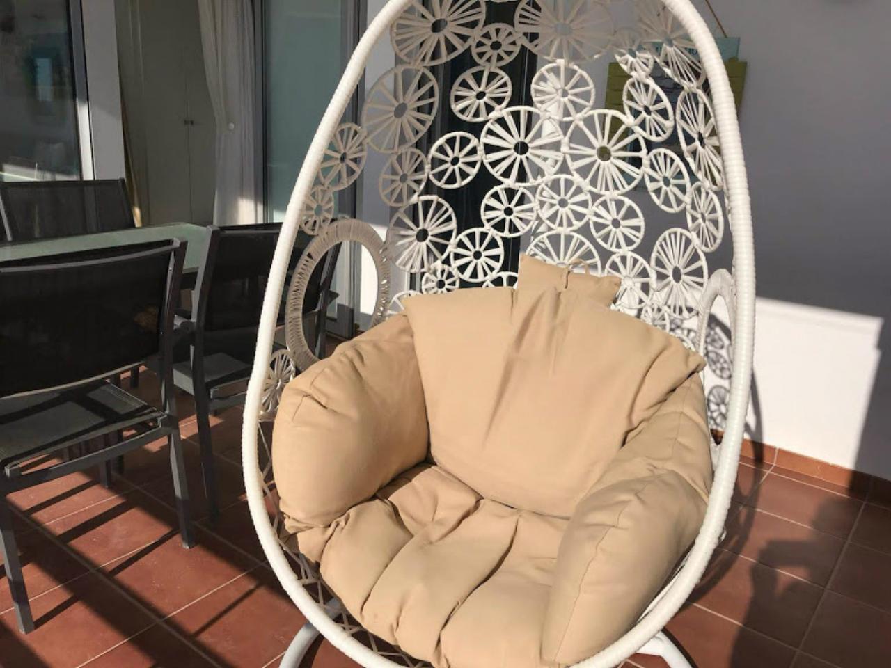 Swing armchair on terrace