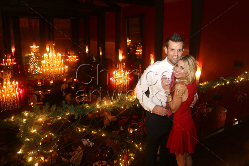 Couple portrait at holiday party.