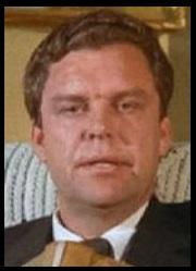 Tom McFadden (Rôle : Le pilote de l'Hélicopter)