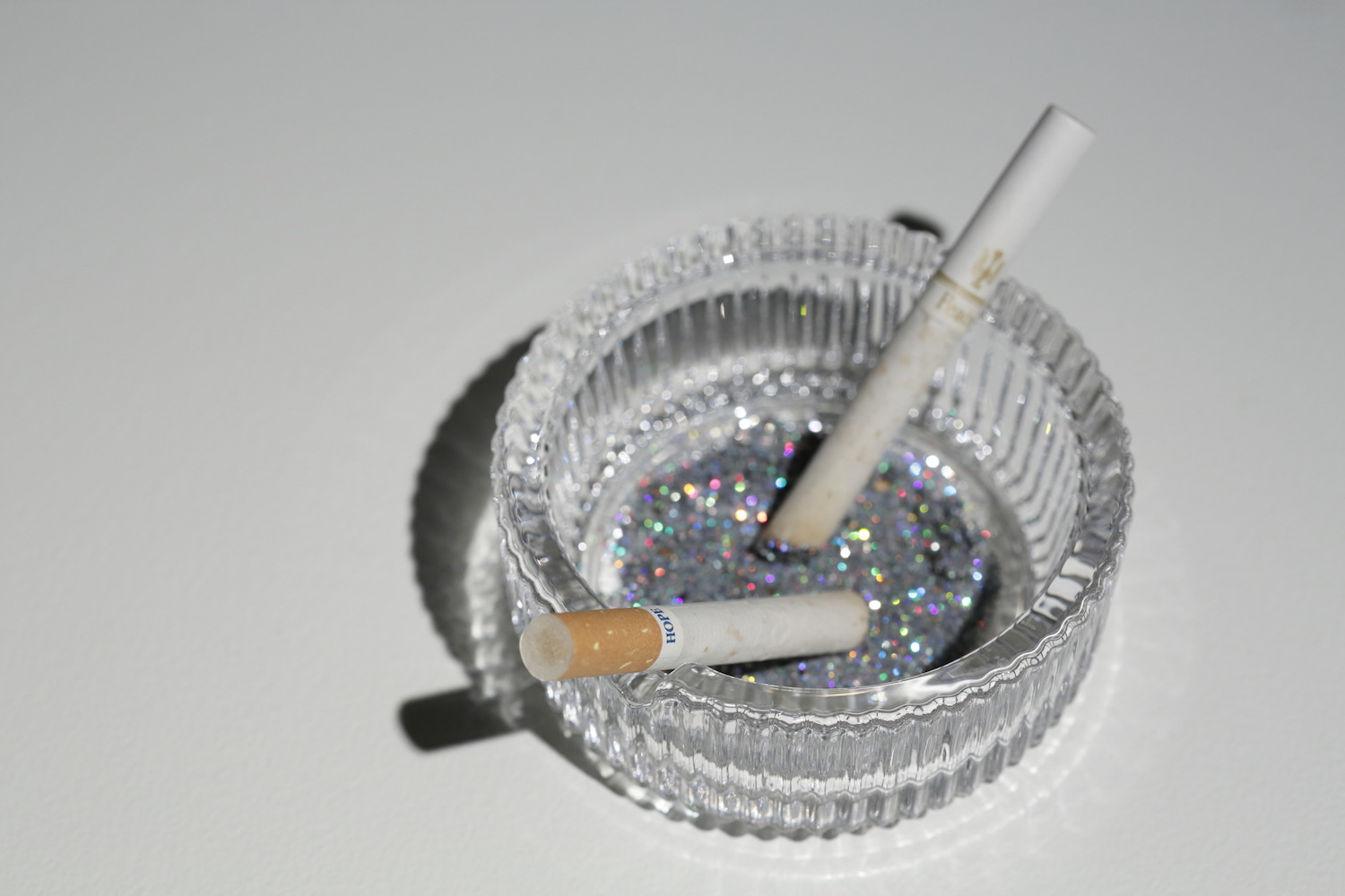 Our Hope, 2012, ashtray, cigarettes, glitter, ashes