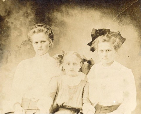 "Three daughters of Joseph ""Joe"" Calvestus PIERCE and Lucinda Jane ""Lucy J"" SMITH, who lived on farm near Winnsboro, TX. Left:  Bertha E., Center:  Virgie Mae, Right:  Maggie D. (b May 1892, Franklin Co., TX)"