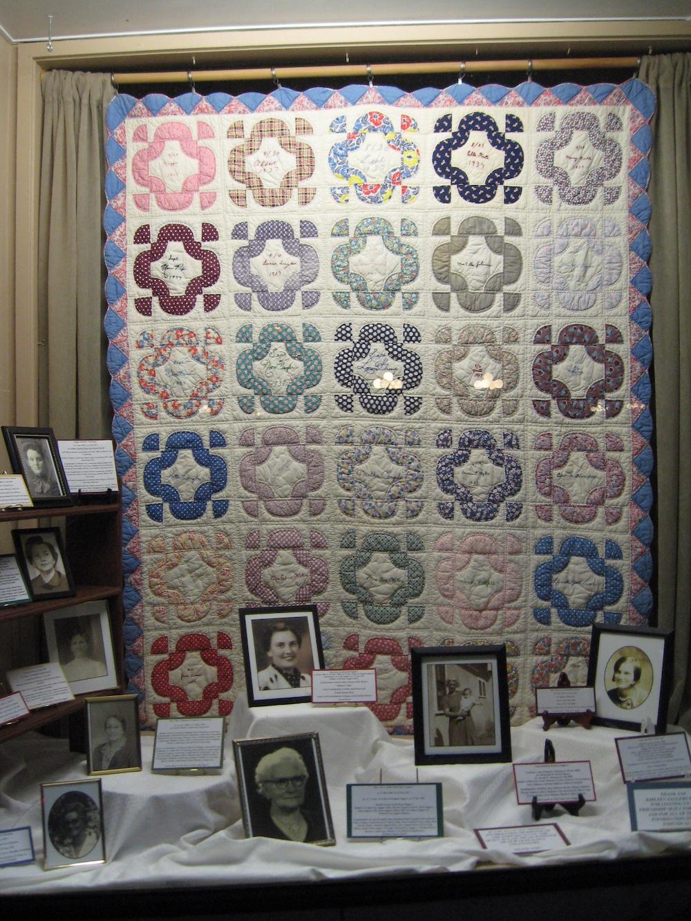 FCGS window of display of Kirleen Hiett's 1937 Friendship Quilt, Sept. 2016