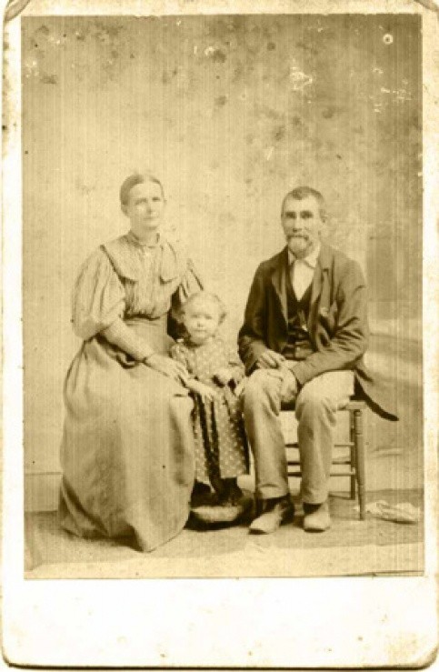 Late 1895/early 1896, William Andrew Jackson HOUGH and Sarah Elizabeth BOWERS with granddaughter Mollie Lee FORGY, only daughter of Mollie Jane HOUGH and Vermont FORGY and Mollie Jane HOUGH. Mollie Jane died when Mollie Lee was an infant.