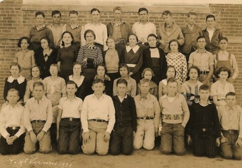 Mt Vernon School, 1934, Franklin County, Texas. Submitted by John Scott. IDs:  Allie Christine Hester, 3rd row up, 5th person from right to left, with large white collar and belt.