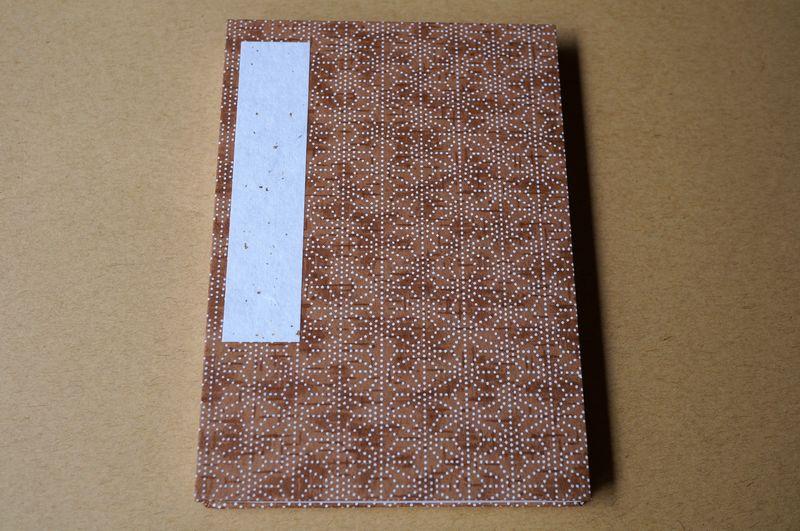 茶色にドットで麻の葉柄が表紙の御朱印帳