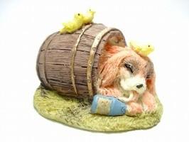 Sleeping dog in barrel