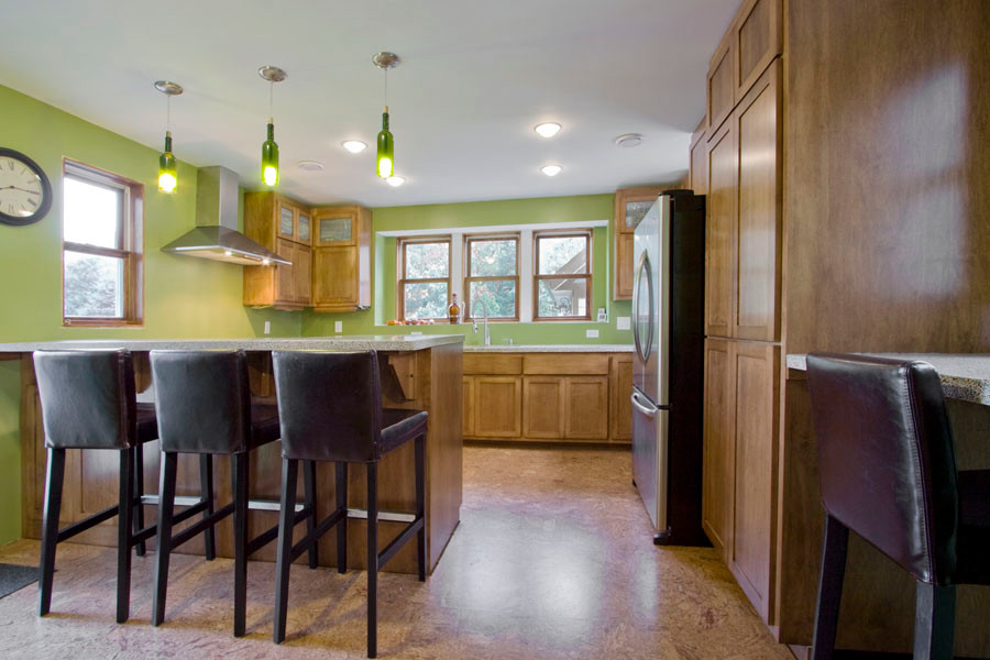 Asper House: Green Remodeling and Addition - Clean, green, durable Kitchen with cork flooring and recycled wine bottle light fixtures.