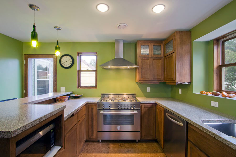 Asper House: Green Remodeling and Addition - Clean, green, durable Kitchen with sexy new countertops, cabinets and appliances.