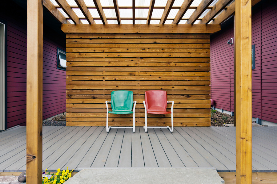 Owens-Pike Net Zero Energy Home: A covered trellis helps provide a link to the entry and a place to sit if you get tired on the way.