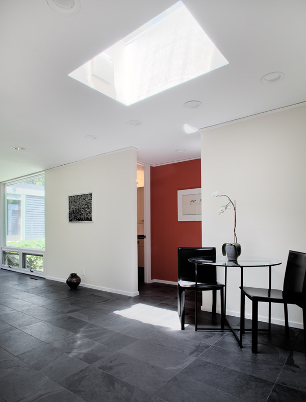 Fredrickson Nagle House: The skylight above helps mark the entry to the shared bath and Master suite.
