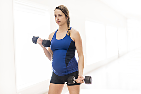 Pregnant Women with Dumbbells