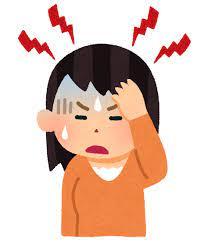 頭痛がひどい女性
